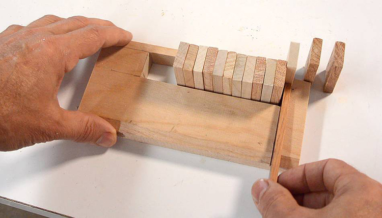 Expert Woodworker Demonstrates How he Made a Wooden Domino Row Building Machine