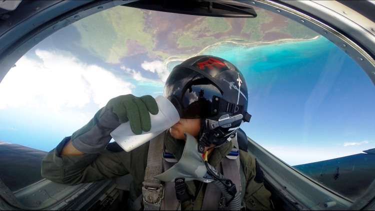 Fighter Pilot Drinks Water While Doing Barrel Rolls in a High Flying Jet