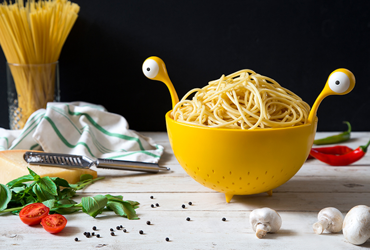 A Fun Big Eyed Yellow Colander That Resembles the Flying Spaghetti Monster When It's Put to Use
