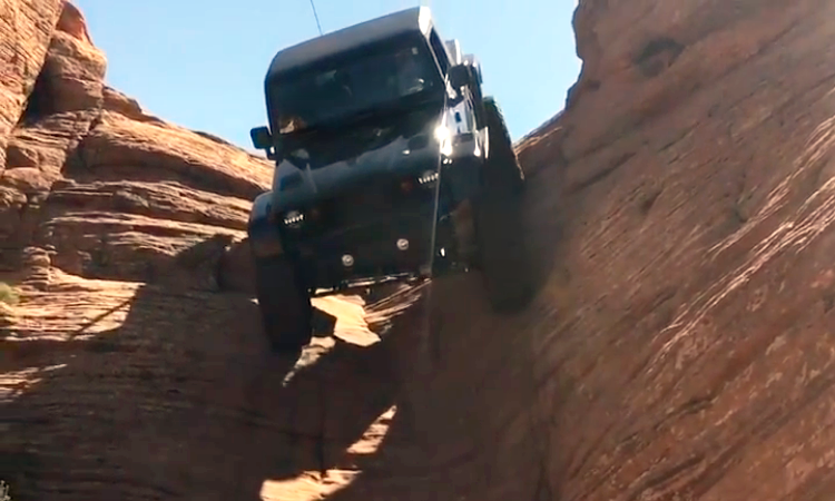 Impressive Demonstration of a Rear Steering Jeep Wrangler Driving Straight Down a Vertical Cliff Wall