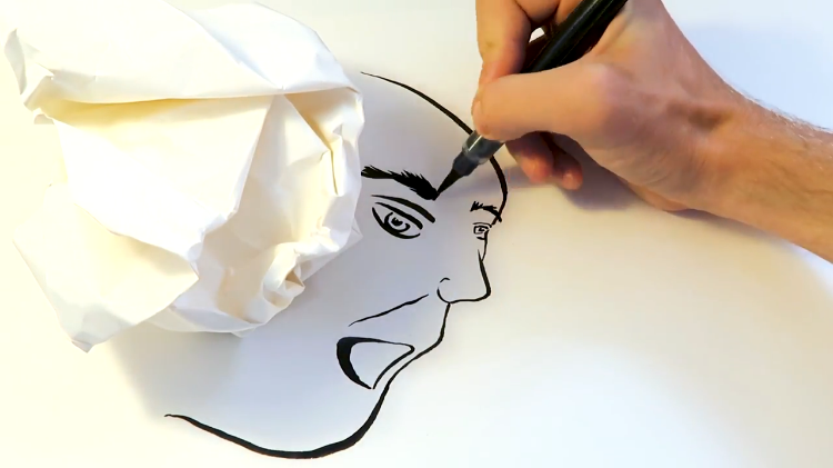 London Artist Draws Strange Faces Using the Shadow of a Crumpled Up Piece of Paper