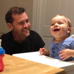 A Happy Little Boy Dances in a High Chair to His Father's Catchy Beatbox Jams