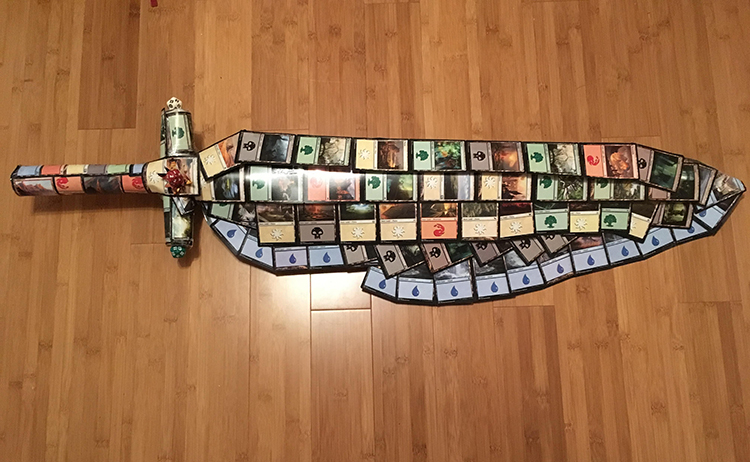 A Lady Makes a Suit of Armor, a Weapon, and a Shield Out of Magic The Gathering Cards