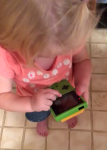 A Little Girl Tries to Play Game Boy Color and Gets Confused by the Lack of Touch Screen