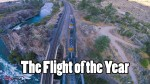 Dizzying Footage From a Drone Performing Amazing Looping Tricks Above Trains, Bridges and Mountains,