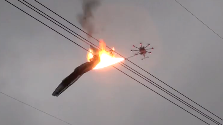 Flame Throwing Drone Removes 40 Feet of Netting Wrapped Around a Power Line in China