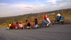 Thrill Seekers in Brazil Engage in an Exciting Downhill Roller-Cart Ride