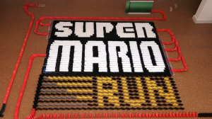 20,000 Dominoes Topple Over in a Display Designed to Look Like Popular Gaming Apps