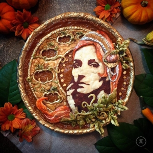 A Beautifully Decorated Pumpkin Pie Featuring an Edible Self-Portrait