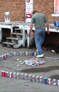 Amazing Man Quickly Crushes a Long Line of Aluminum Cans