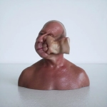 Animation of a Realistic Rubber Face Getting Punched by a Flying Rubber Fist