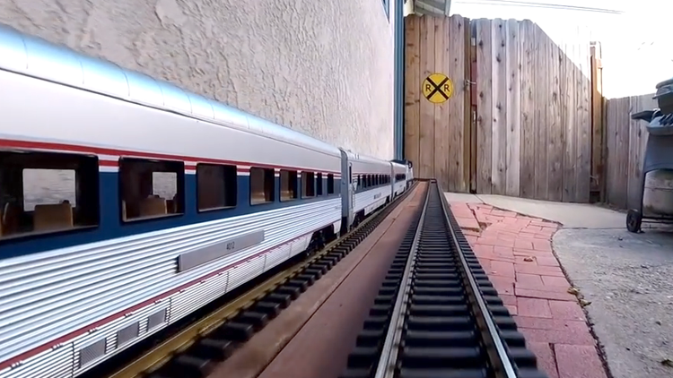 GoPro Footage of an Amtrak Model Passenger Train Traveling Through a House and Backyard