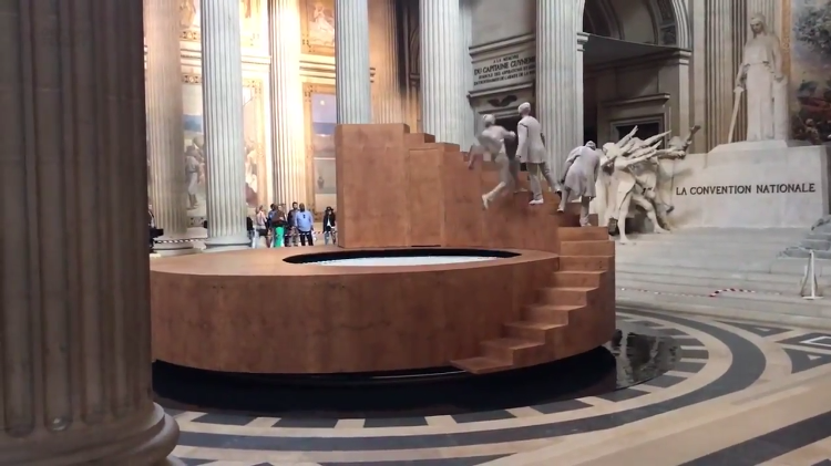 Faceless Dancers Use Trampoline to Rebound Onto a Rotating Stairway in Stunning Panthéon Show