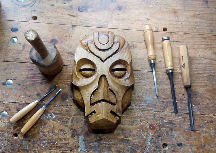 Woodworker Carves Marvelous Skyrim Dragon Priest Masks Out of Reclaimed Pieces of Walnut