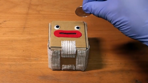 A Cute Cardboard Coin Box That Blasts Open When Money Is Put Into Its Mouth