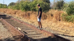 A Man Builds an Electric Skateboard and Rides It on Abandoned Railroad Tracks