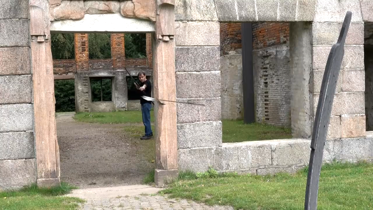 Danish Archer Lars Andersen Fires 'Turning Arrows' Around People and Other Objects