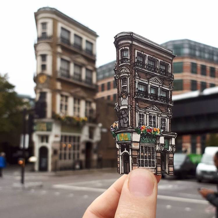 Extremely Detailed Hand Drawn Cut Outs of British Pubs Held Up Against the Original Buildings