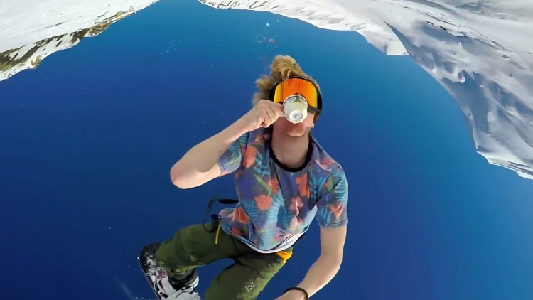 Snowboarder Films Himself Drinking Coffee While Doing a Back Flip