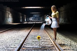 Watering a Sunflower in the Subway