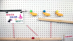 A Little Red Ball Goes on an Incredible Pegboard Wall Mounted Chain Reaction Adventure
