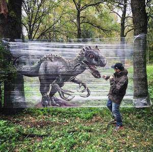 Artist Paints Images of Animals on Clear Plastic Cellophane That's Wrapped Around Two Trees