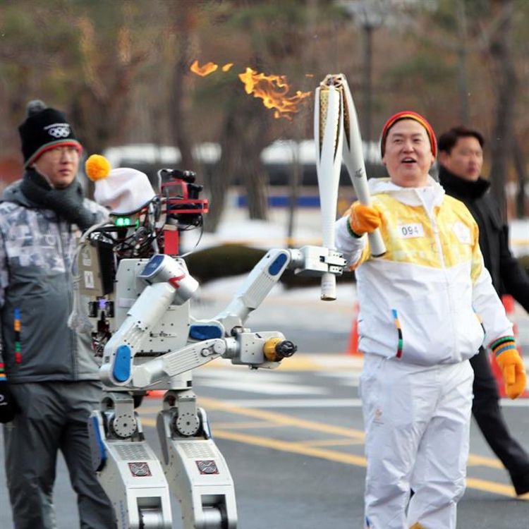 HUBO the Humanoid Robot Cuts a Hole in Wall to Pass On the Olympic Torch in South Korea