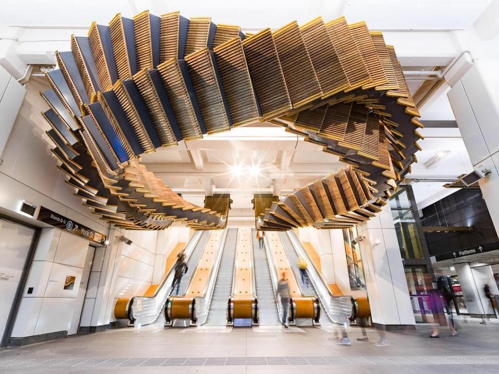 A Beautiful Historic Wooden Escalator Sculpture Suspended Above Its Modern Replacements