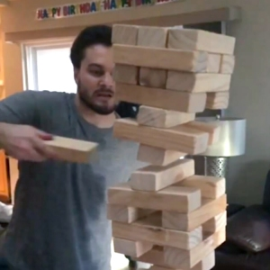 Jenga Wizard Pulls a Single Wooden Block Out From the Center of a Giant Stack and It Stays Up