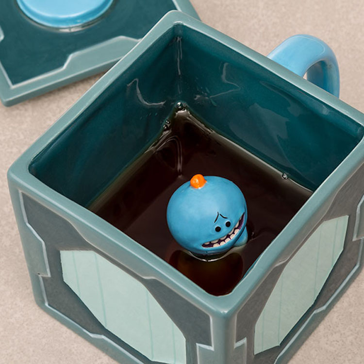 A Rick and Morty Box Shaped Coffee Mug With a Very Helpful Mr. Meeseeks Waiting Inside