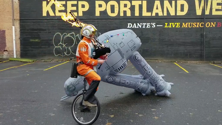 The Unipiper Dresses as a Rebel Pilot and Takes Down an AT-AT While Playing Flaming Bagpipes