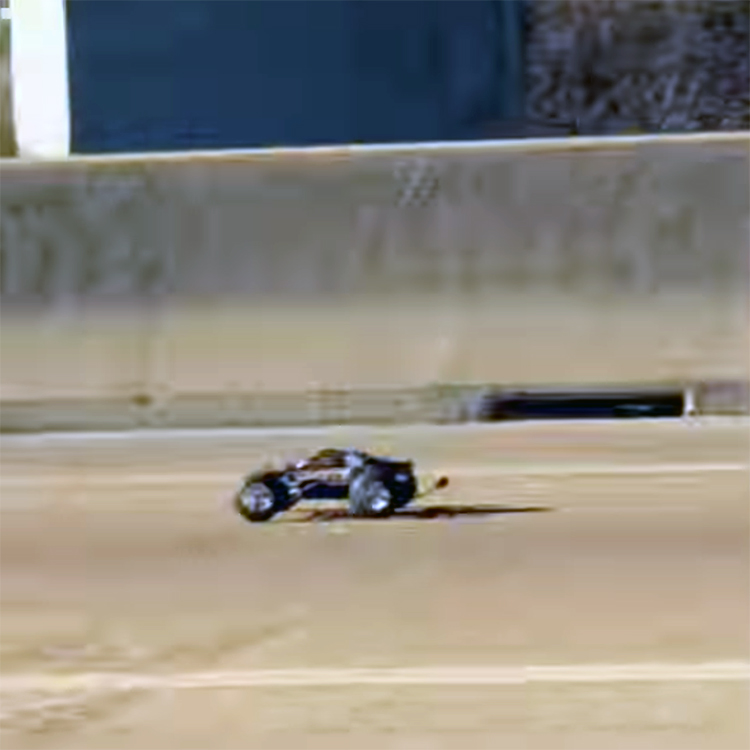 A Remote Controlled Car Spotted Racing After A White Truck On