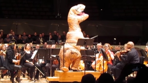 A T-Rex Conducts the Colorado Symphony Playing John Williams' Classic 'Jurassic Park' Theme Song