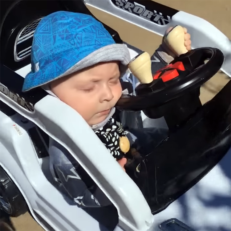 Adorable Infant Falls Asleep at the Wheel While Driving His Electric Toy Car Around in Circles