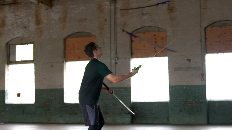 Courageous Man Sets Guinness World Record for Juggling Four Samurai Swords