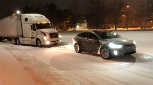 Tesla Model X Electric SUV Tows a Stuck Semi Truck Out of the Snow