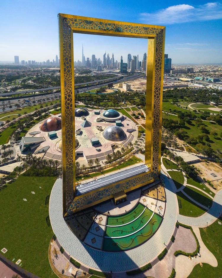 A Giant Interactive Glass and Gold Picture Frame Sculpture That ...