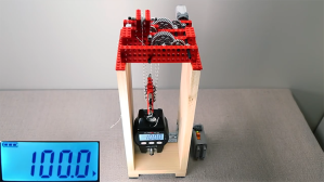 A LEGO Motor and Pulley Rig Lifts 220 Pounds