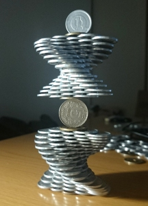 A Man With a Steady Hand Stacks Coins to Create Gravity Defying Sculptures