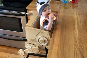 A Wooden Star Wars High Chair That Looks Like an AT-ST Walker