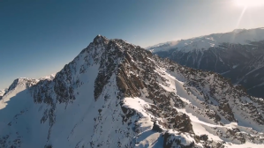 Beautiful Aerial Footage Shot From Two Drones Flying Over Snow Covered Terrain
