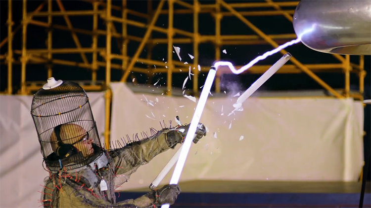 Dr. MegaVolt Interacts With a Super High Voltage Tesla Coil in Slow Motion