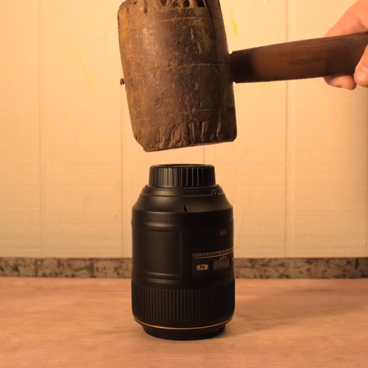 A Nikon Camera Lens Is Pounded Down Into a Lens Cap in a Brilliant Stop-Motion Animation by PES