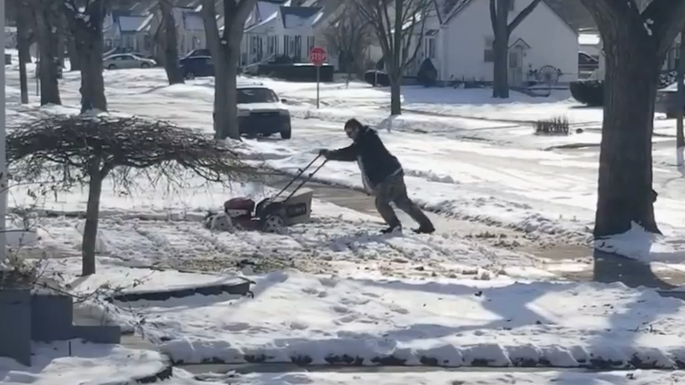 Michigan Man Tries To Mow His Lawn That Is Covered In Snow