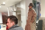 Two Kids Disguised as One Tall Man in a Trench Coat Try to Get Into 'Black Panther'