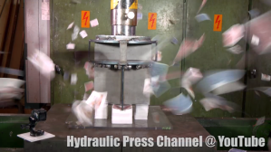 A Hydraulic Press Cuts Through 20 Decks of Playing Cards With Four Giant Blades