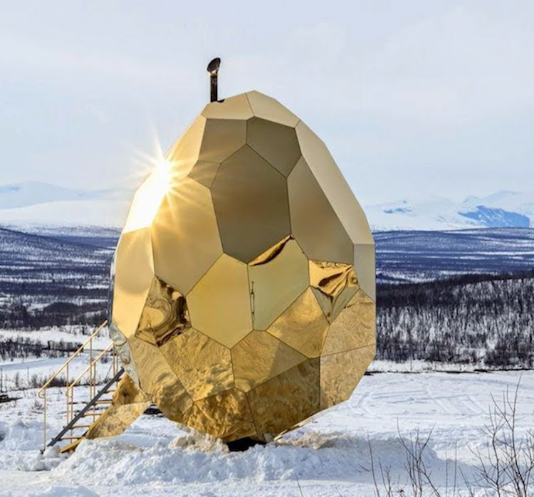 A Multi-Faceted 16 Foot Golden Egg With a Beautiful Pine Sauna Interior That Sits in Kiruna, Sweden