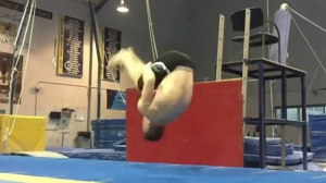 Michigan Gymnast Performs Amazing Hands-Free Backflip From a Seated Position