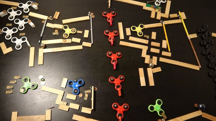 An Elaborate Rube Goldberg Maze That Connects the Fluid Motion of Fidget Spinners With Marbles