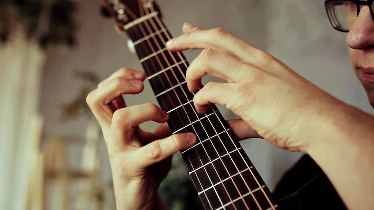 An Upbeat Acoustic Cover of the A-ha Song 'Take On Me' Performed in Gorgeous Guitar Finger Style